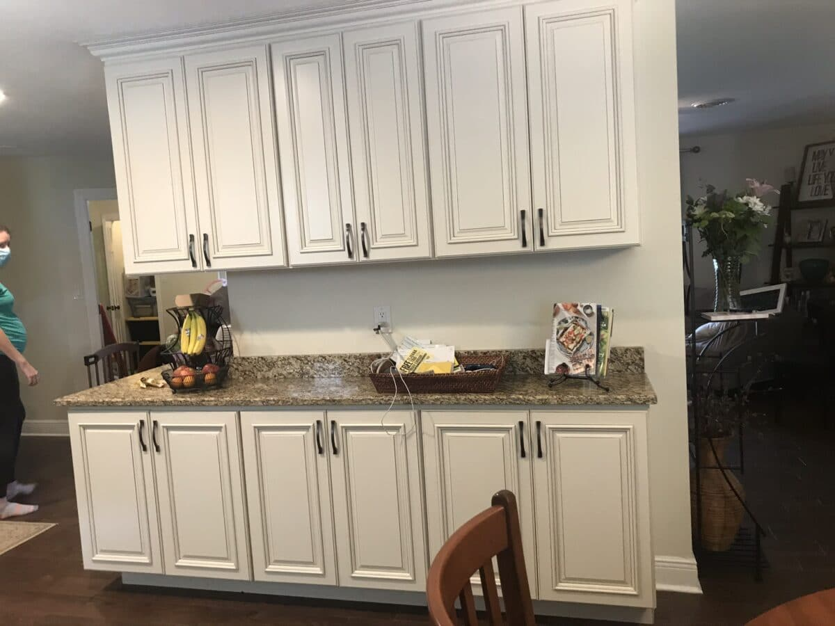 kitchen cabinets on the backside of a fireplace